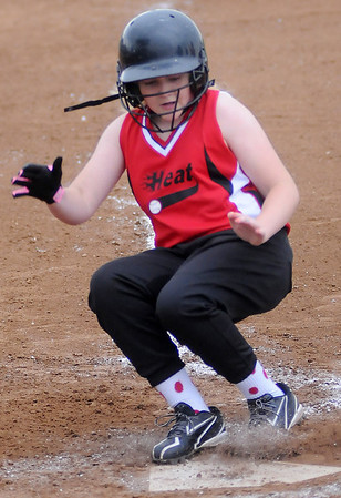 Heat's Avery Dugger scores during the Summer Smash 10-under softball tournament at Government Springs Park Saturday, May 18, 2013. (Staff Photo by BONNIE VCULEK)