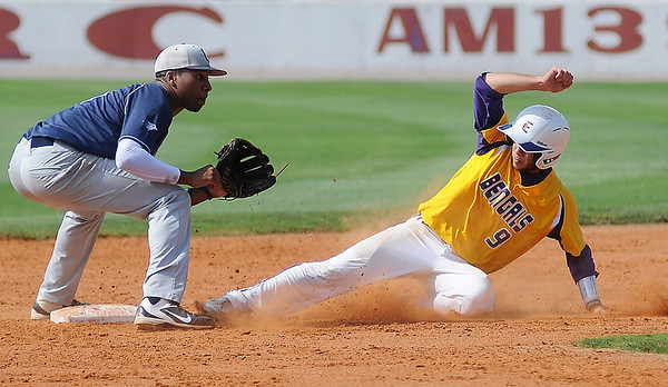 LSU-Eunice's Casey Rodrigue steals second as Lackawanna College's Ronnie Sherman waits on the throw during the 75th annual NJCAA World Series Division II opening game at David Allen Memorial Ballpark Saturday, May 25, 2013. (Staff Photo by BONNIE VCULEK)