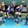 Enid Roller Girls' Tsai N' Hyde, Scream & Sugar, Sassy Wrecker (front, from left)position themselves for a block on Kelley Rip-Her (back, second from right) as they rehearse for their next bout at Skatetown Thursday, May 30, 2013. (Staff Photo by BONNIE VCULEK)