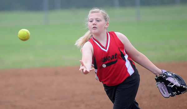 Heat's Avery Dugger pitches. (Staff Photo by BONNIE VCULEK)