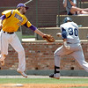 LSU-Eunice first baseman, Stefan Trosclair, reaches to tag Heartland's Cody Dykema, after a high throw during a winners bracket game Thursday in the NJCAA Div II World Series at David ALlen Ballpark. (Staff Photo by BILLY HEFTON)