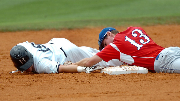 Heartland's Drew Clark keeps a finger tip on second base as Alex Miller of UConn Avery Point maintains contact with his glove during the NJCAA Div II World Series Sunday at David Allen Ballpark. (Staff Photo by BILLY HEFTON)