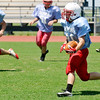 Brock Chance runs the ball during spring football drills Monday at Chisholm High School. (Staff Photo by BILLY HEFTON)