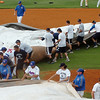 Players from Murray State and Madison CC help pull the tarp over the infield Wednesday in the NCJAA Div II World Series at David Allen Ballpark. (Staff Photo by BILLY HEFTON)