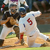 Brunswick Community College catcher, Ryan Brendle, waits to tag out Murray State's Daniel Arthur at home during the NJCAA Div II World Series Saturday at David Allen Ballpark. (Staff Photo by BILLY HEFTON)