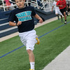 Prairieview's Maddox Mayberry sprints across the finish line well ahead of the other 800 meter runners during the 73rd annual Kiwanis Little Olympics at D. Bruce Selby Stadium Wednesday, May 8, 2013. (Staff Photo by BONNIE VCULEK)