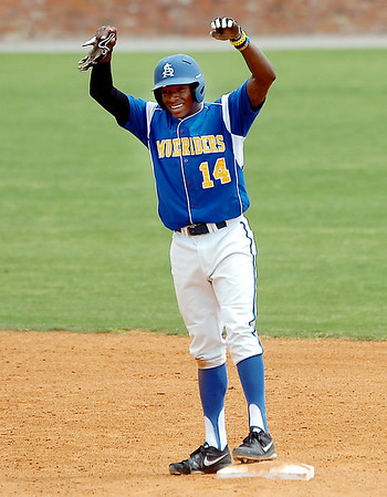 David Harris of Southern Arkansas gestures towards the dugout after reaching second base against Henderson State during an elimination game Monday in the Great American Conference tournament. (Staff Photo by BILLY HEFTON)