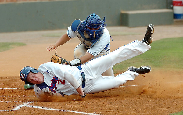 North Iowa catcher, Robert Swenson, tags out Murray State's Brandon Grimsley at home during an elimination game Wednesday in the NCJAA Div II World Series at David Allen Ballpark. (Staff Photo by BILLY HEFTON)