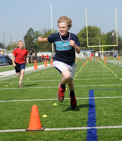 Prairieview's Titan Stevens wins his 100 meter dash heat during the 73rd annual Kiwanis Little Olympics at D. Bruce Selby Stadium Wednesday, May 8, 2013. (Staff Photo by BONNIE VCULEK)