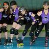 Enid Roller Girls' Tsai N' Hyde, Kelley Rip-Her, Scream & Sugar and Sassy Wrecker  rehearse for their next bout at Skatetown Thursday, May 30, 2013. (Staff Photo by BONNIE VCULEK)
