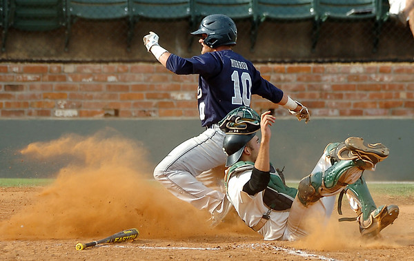 Madison's Rex Morrow scores over Scottsdale catcher, Connor Sabanosh, during an elimination game Tuesday in the NJCAA Div II World Series at David Allen Ballpark. (Staff Photo by BILLY HEFTON)