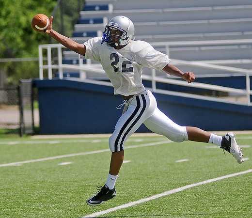 Squire Logan pulls in a one-handed catch during the Enid Plainsmen's spring practice at D. Bruce Selby Stadium Wednesday, May 22, 2013. (Staff Photo by BONNIE VCULEK)