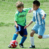 Bryson Schroeder, of the Goal Kickers and Joshua Vega, of Manchester United, contest for the ball during the finals of the Enid Soccer Club Spring Recreational Tournament Sunday at the Enid Soccer Complex. (Staff Photo by BILLY HEFTON)