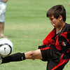 Atlas' Diego Gonzales strikes the ball during the finals of the U-10 Enid Soccer Club Spring Recreational Tournament Sunday at the Enid Soccer Complex. (Staff Photo by BILLY HEFTON)