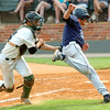Scottsdale catcher, Connor Sabanosh, has the ball knocked away by Madison's Greg Rhude during an elimination game Tuesday in the NJCAA Div II World Series at David Allen Ballpark. (Staff Photo by BILLY HEFTON)