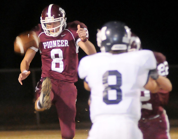 Pioneer's Blake Gabriel punts under pressure against the Minco Bulldogs Friday at Mustang Field. (Staff Photo by BONNIE VCULEK)