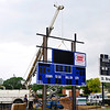 A crane holds in place a section of the new scoreboard being installed at D. Bruce Selby Stadium. (Staff Photo by BILLY HEFTON)