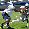 Raheem Mitchell takes a handoff from Christian Voitik during spring football practice Tuesday at D. Bruce Selby Stadium. (Staff Photo by BILLY HEFTON)
