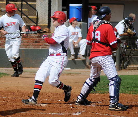 NOC Enid's Russ Colgan (center) scores as the Jets' take a 7-2 lead over the Tonkawa Mavs at David Allen Memorial Ballpark Friday, May 3, 2013. (Staff Photo by BONNIE VCULEK)