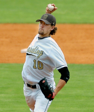 Harding's Hayden Shirley delivers a pitch against SWOSU Sunday during an elimination game in the Great American Conference tournament at David Allen Memorial Ballpark. (Staff Photo by BILLY HEFTON)