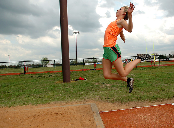 OBA's Erin Coffin practices the long jump Wednesday at the OBA track in preparation for the state track meet. (Staff Photo by BILLY HEFTON)