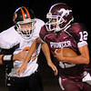 Pioneer's Jett Jobe avoids a tackle by Snyder's Cole White Friday during the Mustangs' game against the Cyclones at Mustang Field. Snyder led 14-12 at the half. (Staff Photo by BONNIE VCULEK)