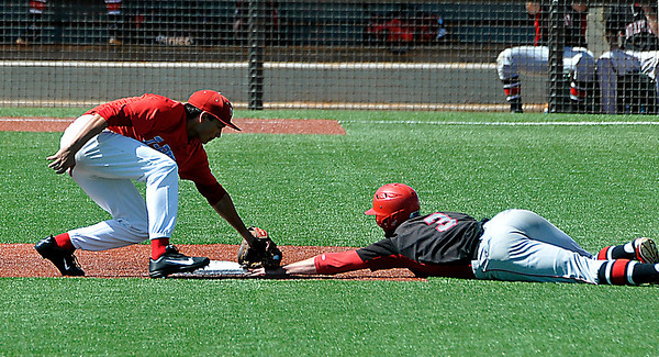 NOC Enid's Korbin Polston is tagged out by Casey Moses of Mesa CC Monday after over sliding second base during an elimination game in the NJCAA DII World Series at David Allen Memorial Ballpark. (Staff Photo by BILLY HEFTON)