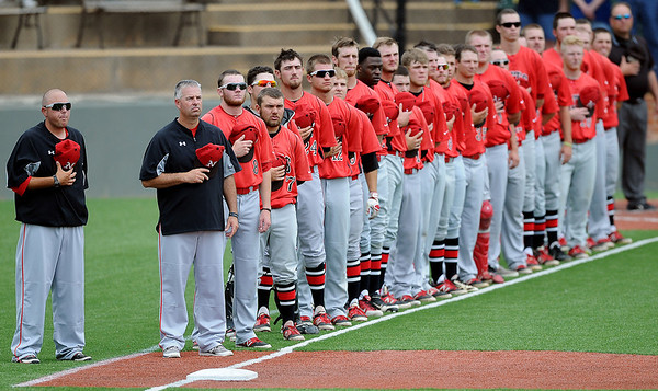 NOC Enid Jets pause for the National Anthem before their game against Southeastern Community College during the NJCAA Division II World Series at David Allen Memorial Ballpark Saturday, May 24, 2014. (Staff Photo by BONNIE VCULEK)