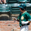 Arkansas Tech's James Sharp smiles as he crosses home plate after hitting a home run against SWOSU during the Great American Conference Tournament Sunday at David Allen Memorial Ballpark. (Staff Photo by BILLY HEFTON)