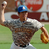 SAU's Yumezo Densaki pitches during the Great American Conference Championship game at David Allen Memorial Ballpark Tuesday, May 6, 2014. (Staff Photo by BONNIE VCULEK)
