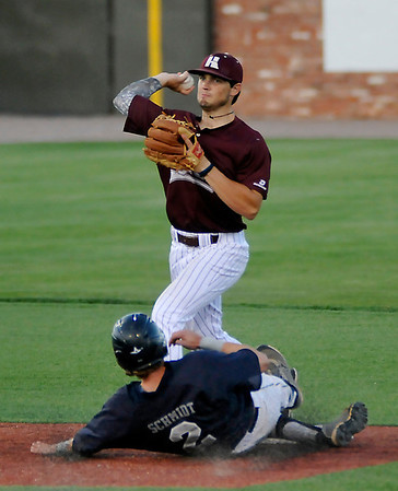 Hinds CC's Matt Jones throws to first over Madison's Dan Schmidt Friday during the Eagles 12-6 win over Madison College to advance to the championship game of the NJCAA DII World Series against Mesa CC at David Allen Memorial Ballpark. (Staff Photo by BILLY HEFTON)