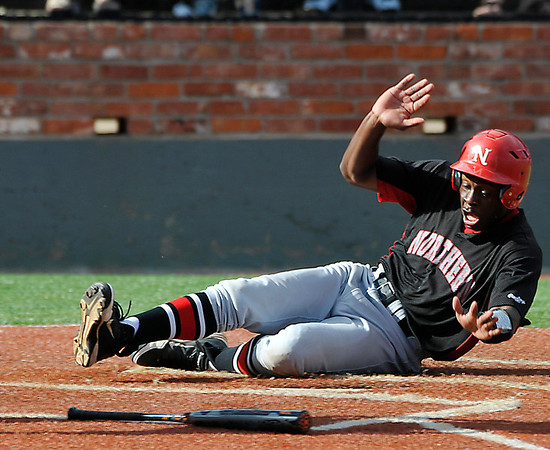 NOC Enid's Nik Gifford slides across home plate against Mesa CC Monday during an elimination game in the NJCAA DII World Series at David Allen Memorial Ballpark. (Staff Photo by BILLY HEFTON)