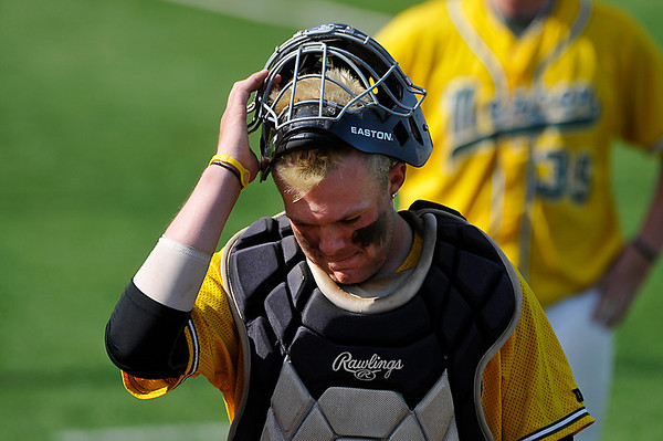 Mercer County CC catcher, Kalyb Smith, wlalks off the field after their 13-3 loss to Pasco Hernando in an elimination game Wednesday during the NJCAA DII World Series at David Allen Memorial Ballpark. (Staff Photo by BILLY HEFTON)