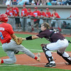 Hinds Community College's Jonathan Washam tags Mesa Community College's Levi Larmour out during the NJCAA Division II World Series championship game at David Allen Memorial Ballpark Saturday, May 31, 2014. Mesa won the game 9-7 in the 11th inning for the title. (Staff Photo by BONNIE VCULEK)