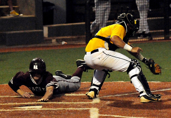 Hinds Community College scores another run against Pasco-Hernando State College during the NJCAA Division II World Series at David Allen Memorial Ballpark in Enid, Okla. Tuesday, May 27, 2014. (Staff Photo by BONNIE VCULEK)