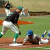 Southern Arkansas University's Tyler Cameron beats the tag at first as University of Arkansas at Monticello's pitcher Kade Garlington and Bronson Gillam keep the runner close to the bag during the Great American Conference Championship game at David Allen Memorial Ballpark Tuesday, May 6, 2014. (Staff Photo by BONNIE VCULEK)