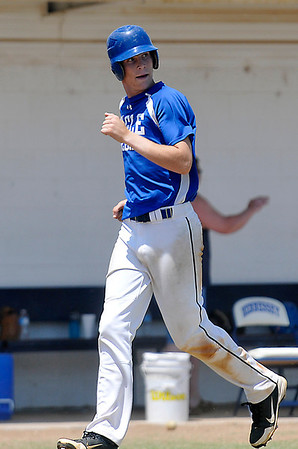 Hennessey's Matthew Mills stares down the UNion City pitcher after hitting a home run Saturday during the championship game of the regional tournament at Hennessey High School. (Staff Photo by BILLY HEFTON)