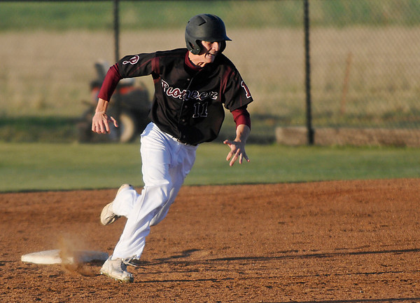 Pioneer's Collin Mason heads for third with a triple against Drummond Friday during the regional tournament at Pioneer High School. (Staff Photo by BILLY HEFTON)