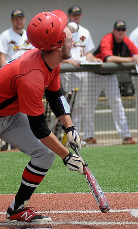 NOC Enid Jets' Korbin Polston bunts, bouncing the ball off the left side of his face and over his head during the NJCAA Division II World Series game against the Southeastern Community College Blackhawks at David Allen Memorial Ballpark Saturday, May 24, 2014. (Staff Photo by BONNIE VCULEK)