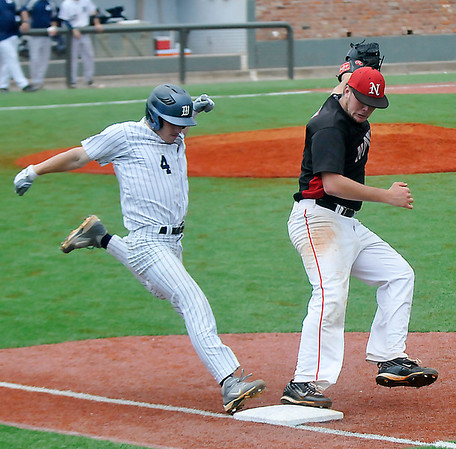 NOC Enid pitcher, Austin Hilton, beats Steve Figueroa of Westchester CC Sunday to first base during a elimination game of the NJCAA DII World Series at David Allen Memorial Ballpark. (Staff Photo by BILLY HEFTON)