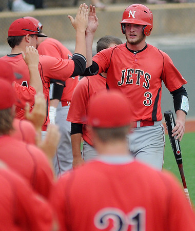 The NOC Enid Jets celebrate Korbin Polston's run in the top of the 10th inning against Southeastern Community College during the NJCAA Division II World Series at David Allen Memorial Ballpark Saturday, May 24, 2014. (Staff Photo by BONNIE VCULEK)
