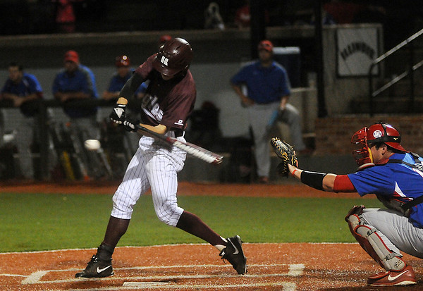 Hinds Community College's Chase Lunceford connects with a pitch during the NJCAA Div. II World Series at David Allen Memorial Ballpark Saturday, May 24, 2014. (Photo by BONNIE VCULEK)