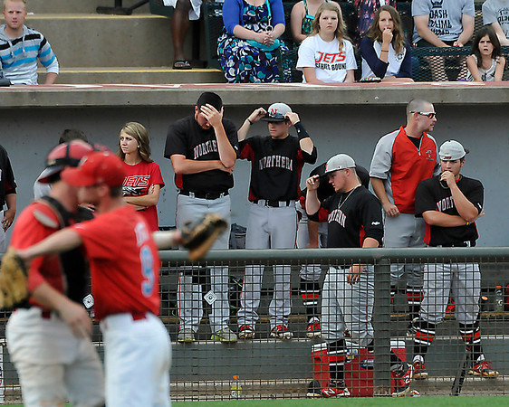 The NOC Enid dugout reacts to the final out in a 10-7 loss to Mesa CC Monday in an elimination game during the NJCAA DII World Series at David Allen Memorial Ballpark. (Staff Photo by BILLY HEFTON)