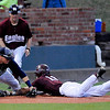 Hinds CC's Luke Reynolds avoids the tag of Madison's Luke Yapp at third Friday during the Eagles 12-6 win over Madison College to advance to the championship game of the NJCAA DII World Series against Mesa CC at David Allen Memorial Ballpark. (Staff Photo by BILLY HEFTON)