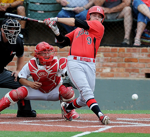 NOC Enid's Russ Colgan drives a single past the infield during a game against Southeastern Community College at David Allen Memorial Ballpark during the NJCAA Division II World Series Saturday, May 24, 2014. (Staff Photo by BONNIE VCULEK)