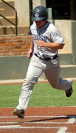 SWOSU's J. R. Head scores the Bulldogs' first run against the University of Arkansas-Monticello during the Great American Conference Championship Tournament at David Allen Memorial Ballpark Saturday, May 3, 2014. (Staff Photo by BONNIE VCULEK)