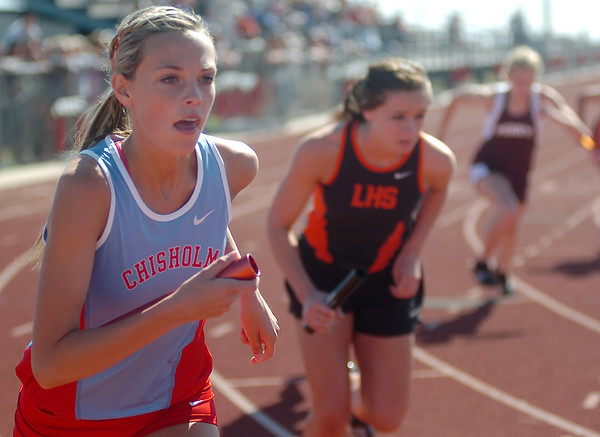Chisholm's Falon Robinett begins the first leg of the Class 3A girls 3200 Relay during the regional track meet at Chisholm High School Saturday, May 3, 2014. The relay team of Robinett, Megan Galusha, Logan Amsler and Kaci McCary won the event. (Staff Photo by BONNIE VCULEK)