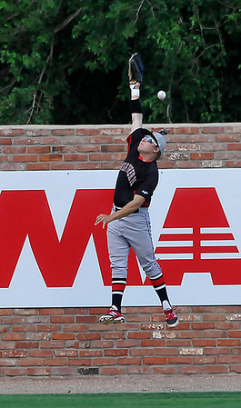 NOC Enid's Russ Colgan just misses a fly ball against Mesa CC Monday during an elimination game in the NJCAA DII World Series at David Allen Memorial Ballpark. (Staff Photo by BILLY HEFTON)