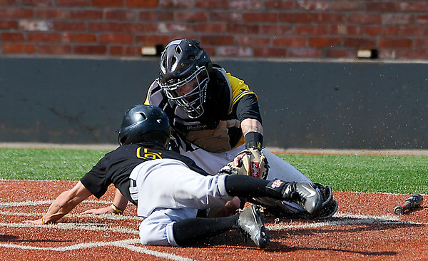 Pasco Hernando's Robbie McCabe slides around the tag of Mercer County CC catcher, Kalyb Smith,  during an elimination game Wednesday in the NJCAA DII World Series at David Allen Memorial Ballpark. (Staff Photo by BILLY HEFTON)
