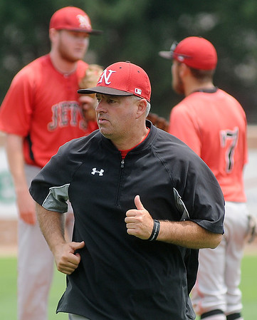 NOC Enid Jets' head coach, Raydon Leaton, returns to the dug out during the NJCAA Division II World Series game against Southeastern Community College Saturday, May 24, 2014. (Staff Photo by BONNIE VCULEK)